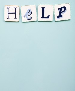 Help sign. Handwritten colors letters word. Light blue background. Calligraphy and lettering fine art.